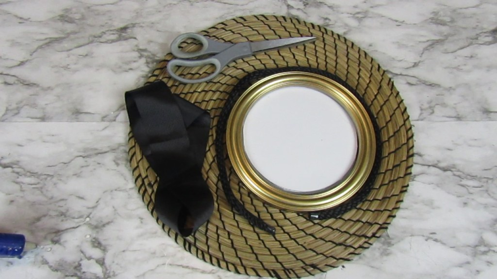 DIY Placemat Wall Decor - IKEA seagrass placemat, dollar tree mirror, ribbon, braided rope and a pair of scissor.